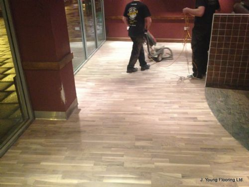 Scrubbing prior to first coat of varnish at May Sum Chinese restaurant, Nottingham